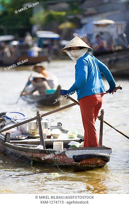 woman, rowing in a boat in a floating market  Mekong delta, Vietnam, Asia