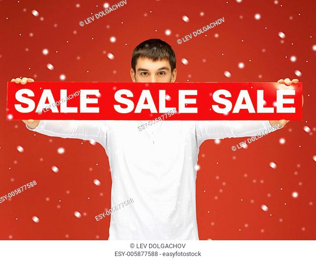 bright picture of man holding sale sign
