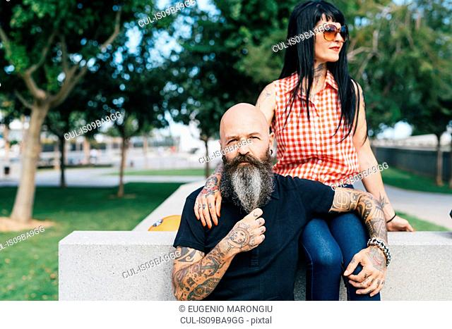 Mature hipster couple in park, portrait, Valencia, Spain