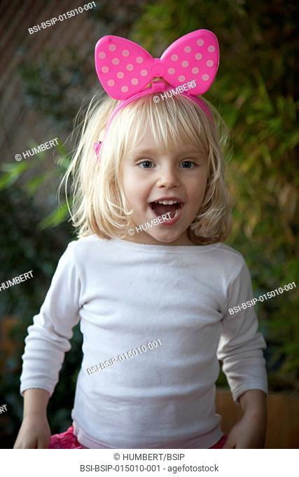 Girl wearing a headband with pink bow