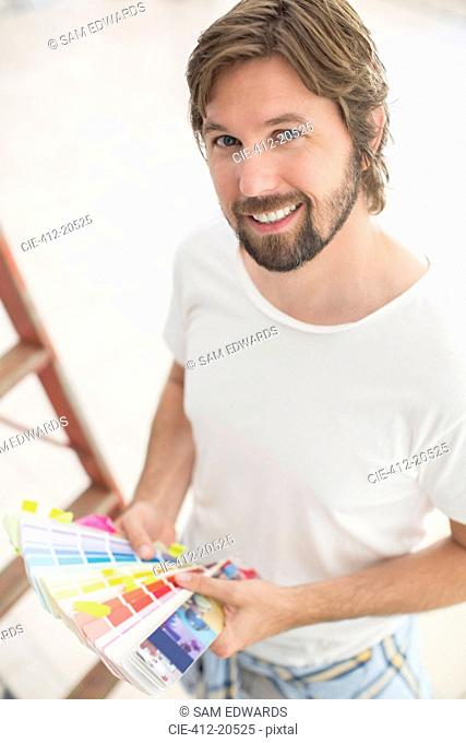 Man looking through color swatches