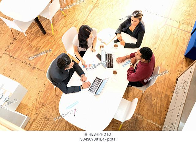 Overhead view of business team meeting at office table