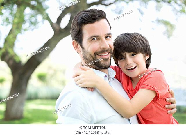 Father and son smiling outdoors