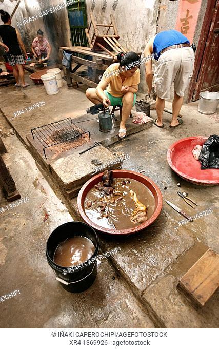 Preparing food, Market Rongjiang, Rongjiang, Guizhou, China