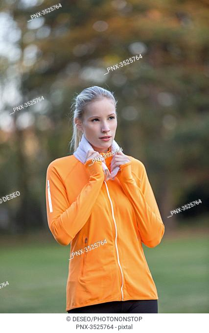 Portrait of a pretty blonde woman doing sport in park