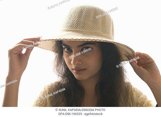 Indian girl wearing hat, pune, maharashtra, india, asia, MR#191