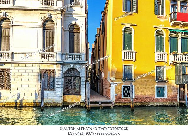 Narrow Venice street between two palaces on the bank of the Grand Canal