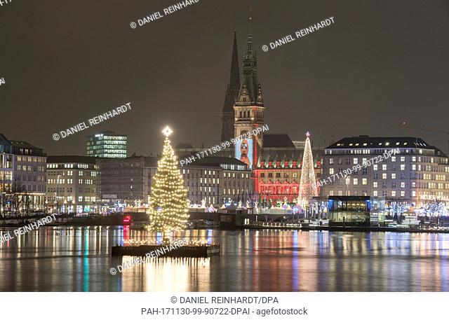 The Christmas tree in the middle of the Binnenalster river, also called 'Alstertanne', is illuminated in Hamburg, Germany, 30 November 2017