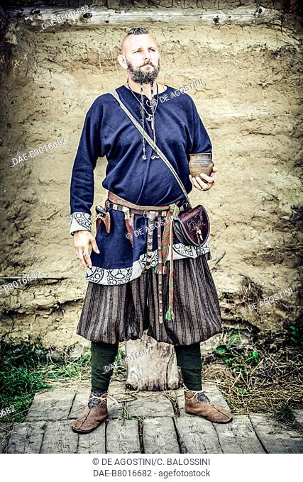Man wearing Rus trousers, Festival of Slavs and Vikings, Centre of Slavs and Vikings, Jomsborg-Vineta, Wolin island, Poland