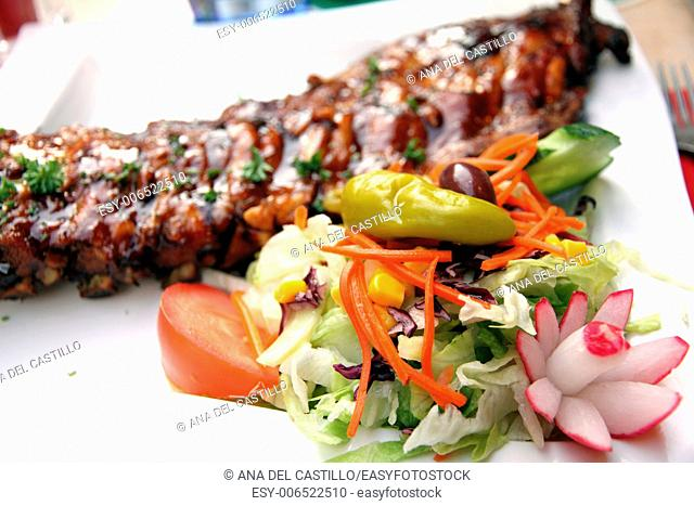 Ribs and salad om plate Amsterdam