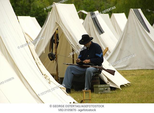 Union soldier cleaning rifle, Civil War Re-enactment, Willamette Mission State Park, Oregon