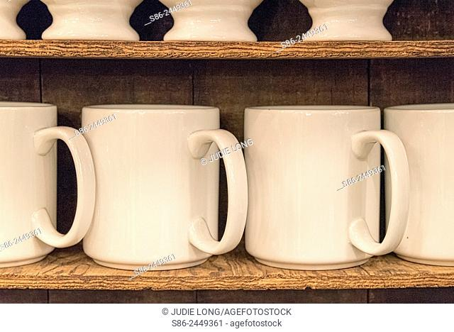 White Pottery Coffee Mugs, Sitting on a Plywood Shelf