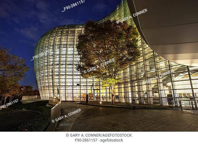 The National Art Center Tokyo exterior at dusk in Roppongi, Tokyo, Japan (architect Kisho Kurokawa)
