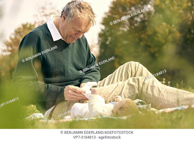 couple, baby, family, age difference, outdoors, in park, generations, Grandfather, at Neuhofener Berg, Munich, Germany
