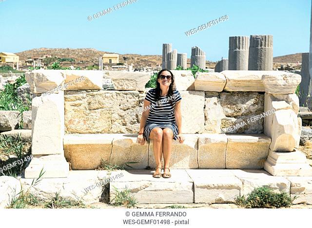 Greece, Mykonos, Delos, tourist visiting archaeological site