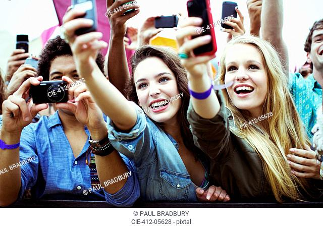 Fans with cameras and camera phones at music festival