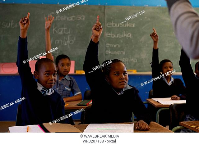 Schoolkids studying in the classroom