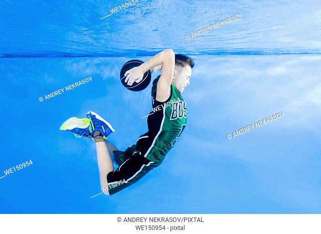 """""""""""""""""""""""Play fashion junior"""""""" - Boy playing basketball under water, Odessa, Ukraine"""