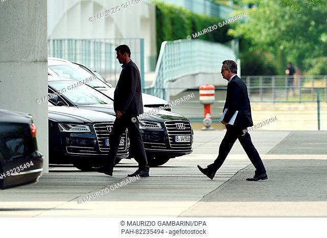 German Chancellor Angela Merkel (r, CDU) arrives for emergency talks on the security situation at the federal chancellery in Berlin, Germany, 23 July 2016