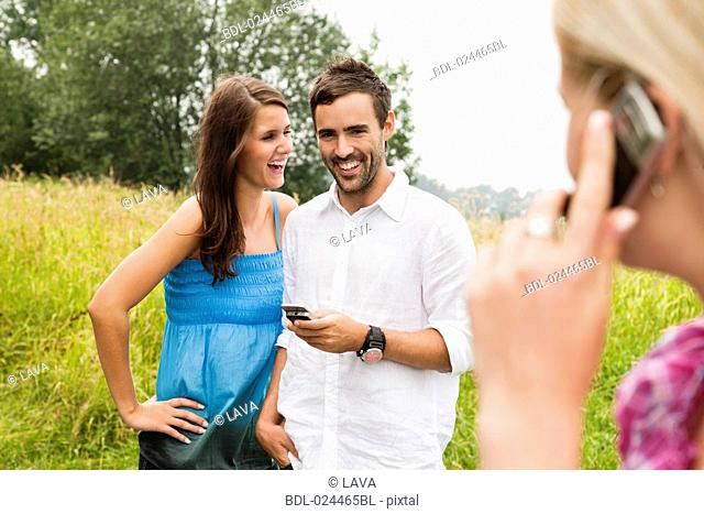 portrait of young couple with mobile phone