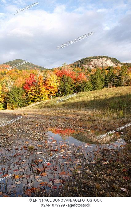 Autumn foliage along the Kancamagus Highway route 112, which is one of New England's scenic byways  Located in the White Mountains, New Hampshire USA