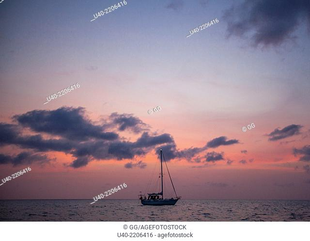 Belize, sailboats on the Caribbean at Sunset