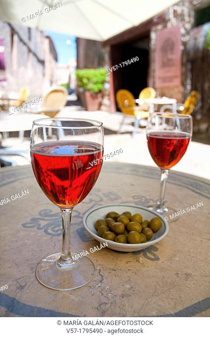 Spanish aperitif: two glasses of rose sparkling wine in a terrace. Spain