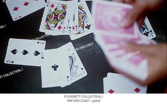 Close-up hands dealing cards