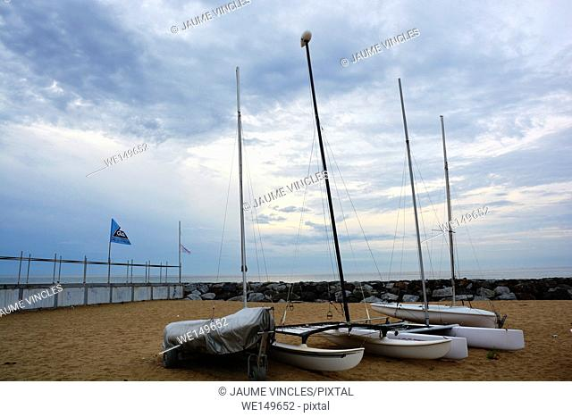 Sailboats on the beach. Caldes d'Estrac, Maresme, Barcelona Province, Spain