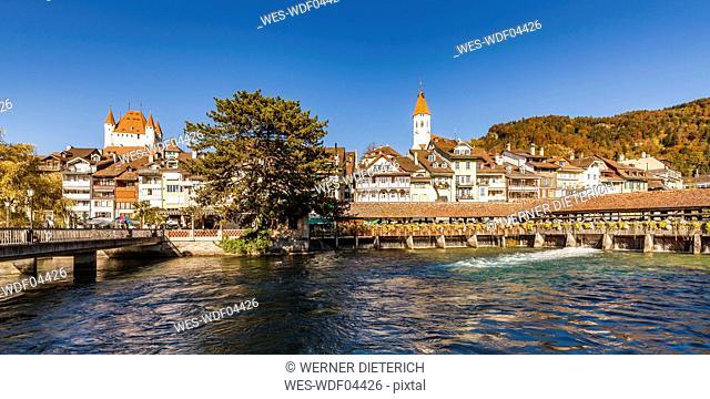 Switzerland, Canton of Bern, Thun, river Aare, old town with parish church, castle and sluice bridge