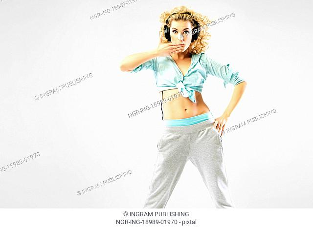 Alluring blond lady with headphones