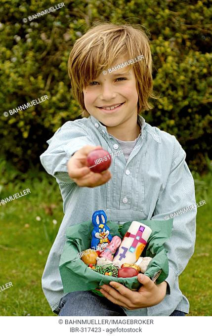 Boy with a easter basket searching easter eggs