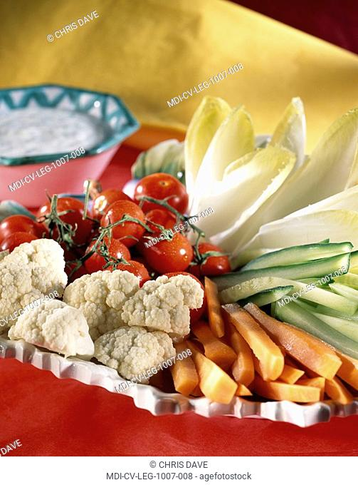Raw vegetables served with coarse salt and a sauces with chives