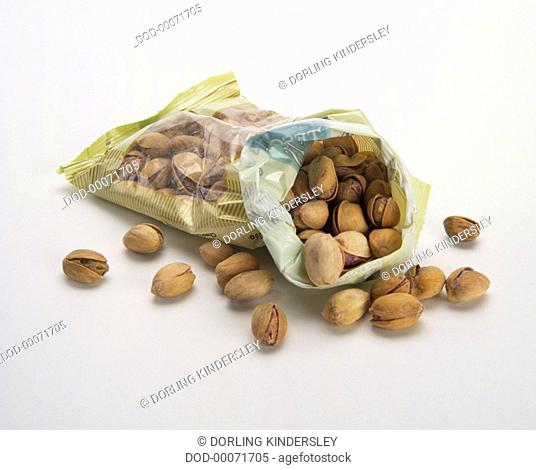 Pistachio nuts spilling from bag