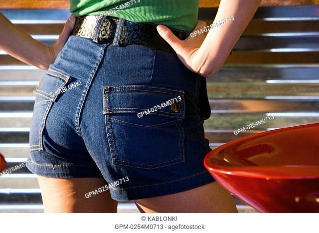 Woman's buttocks in denim shorts