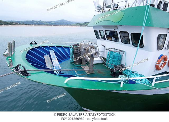 forefront of the bow of a fishing boat docked at the port of San Vicente de la Barquera, Asturias, Spain