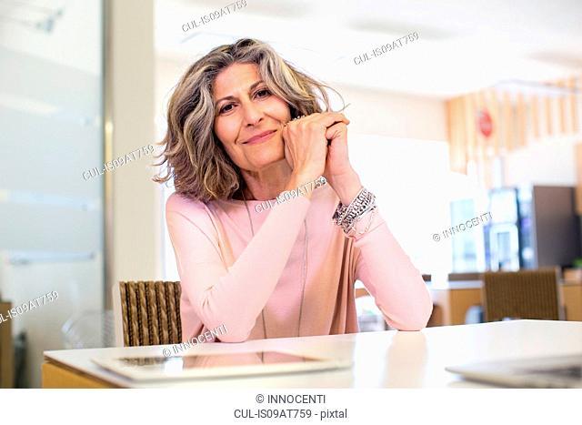 Portrait of senior female designer in office