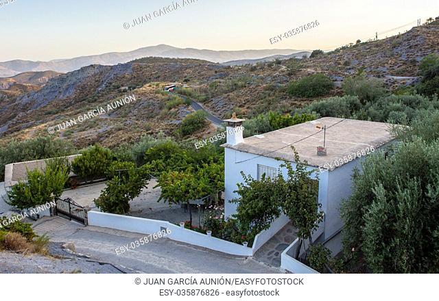 Local bus climbs above the alpujarran Lecrin Valley, Granada, Spain