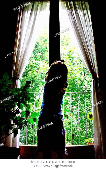 Girl trying to open balcony in rural house