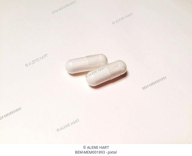Close up of two white pills