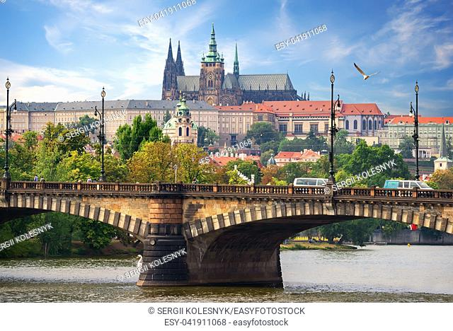 Majestic St Vitus cathedral and Manesuv bridge in Prague