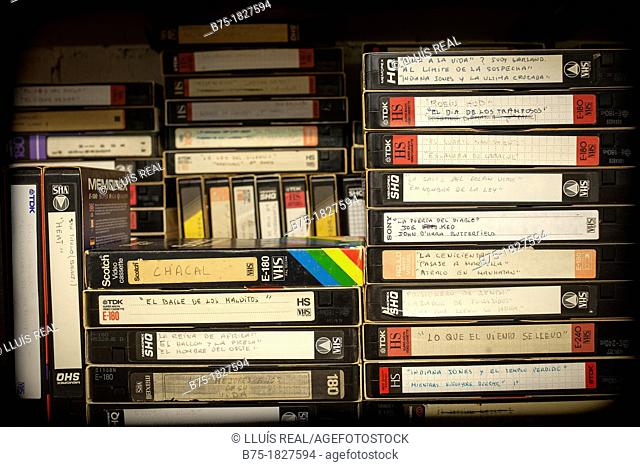 Many VHS videos stacked and grouped, vintage
