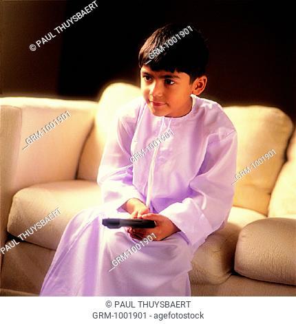 Young Arab boy watching TV