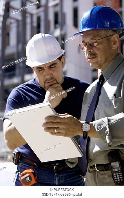 Two foremen discussing at a construction site