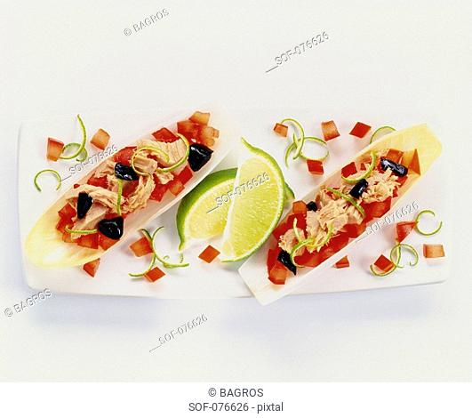 Chicory leaves filled with tomatoes,olives and tuna