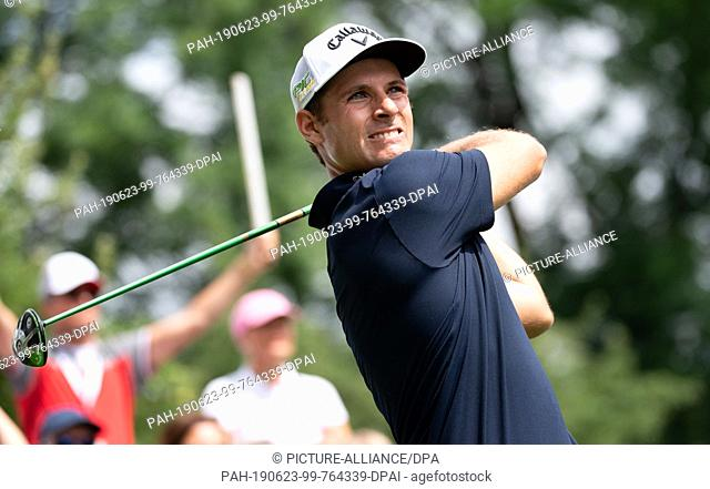 23 June 2019, Bavaria, Eichenried: Golf: European Tour - International Open, singles, men, 4th round. Golf professional Andrea Pavan from Italy looks after his...