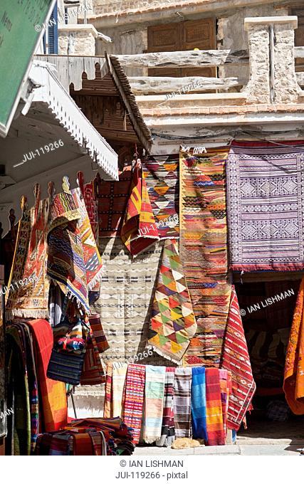Traditional carpets for sale outside carpet shop, Essaouira, Morroco
