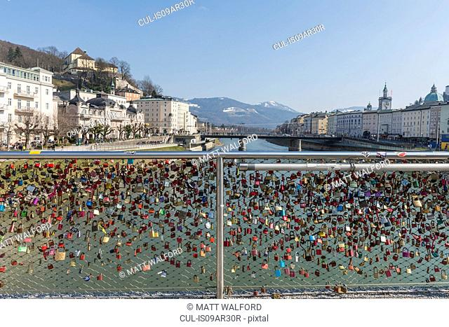 View of love locks on waterfront fence, Salzburg, Austria