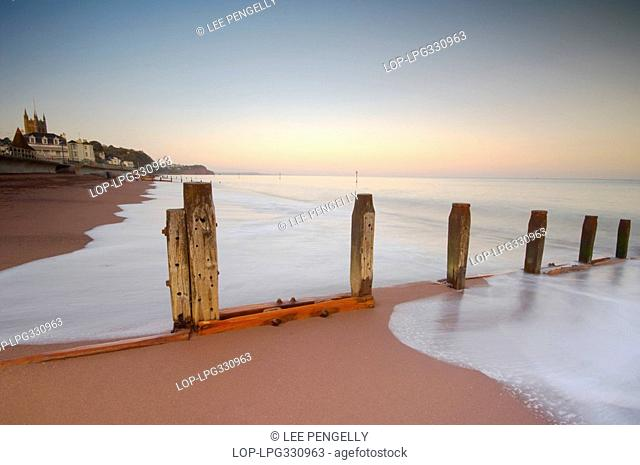 England, Devon, Teignmouth, Waves ebbing from the beach at Teignmouth