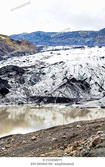 travel to Iceland - dirty Solheimajokull glacier (South glacial tongue of Myrdalsjokull ice cap) in Katla Geopark on Icelandic Atlantic South Coast in autumn